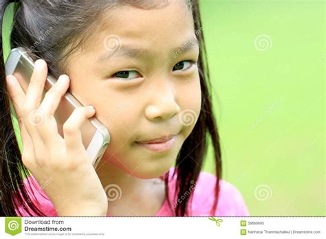 who is the asian girl in the mobile strike commercial close up portrait of asian girl talking mobile phone stock