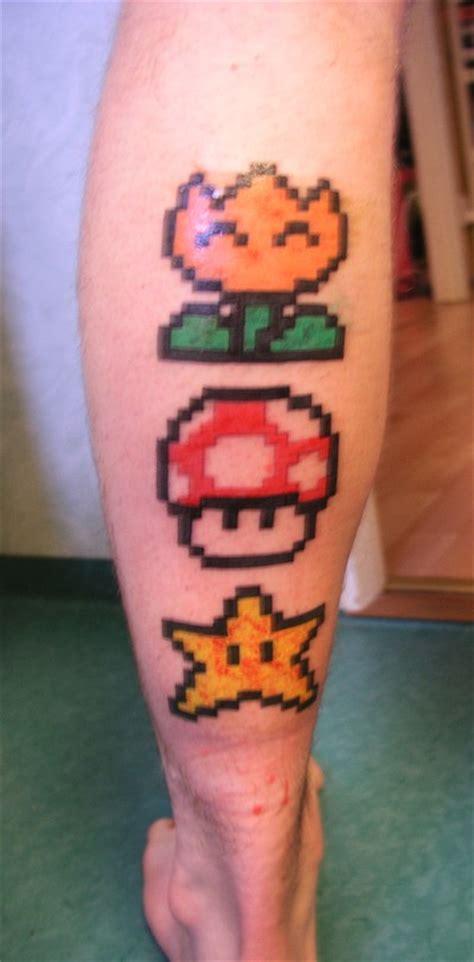 small mario tattoos mario power 16 bits on leg by edholm92