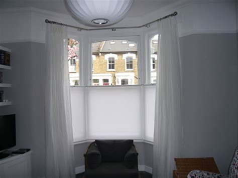curtains that cover bottom half of window baypole with voile curtains and bottom up roller blinds