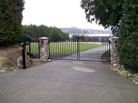 swing gates designs this double swing driveway gate has delicate design