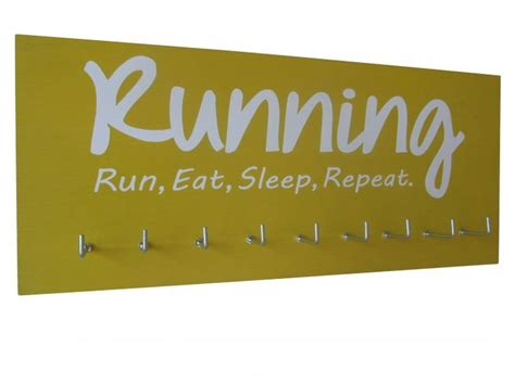 Run Eat Repeat motivational running quotes on medals hanger run eat