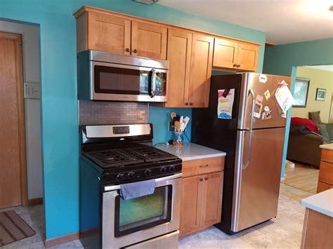 kitchen remodel with maple cabinets and hanstone quartz
