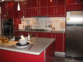 Bright red kitchen cabinets on tile floor facing dust countertop under