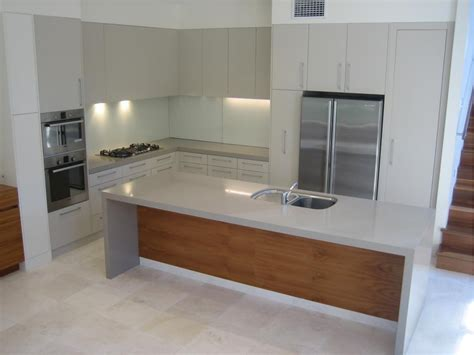 kitchen bench materials polyurethane kitchen with stone tops and veneer island