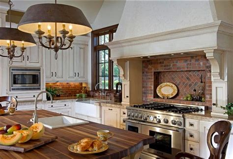 brick backsplash and copper hood would look great with great kitchen with a great mix of finishes painted wood