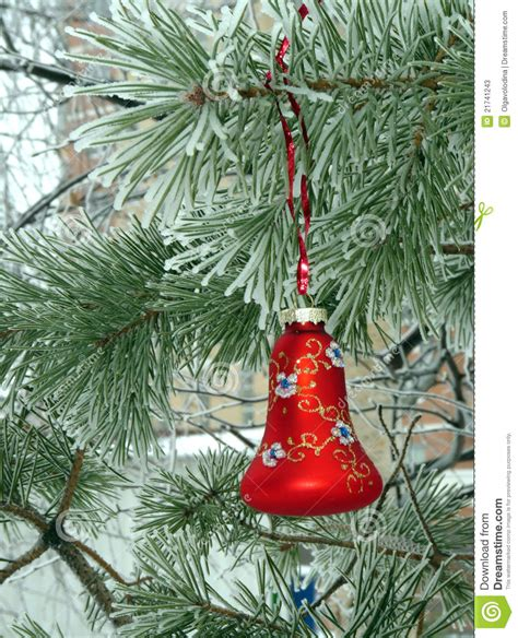 a christmas decorations on a snowy christmas tree stock