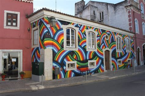 Banksy Wall Mural mar rainbow guardian portugal unurth street art