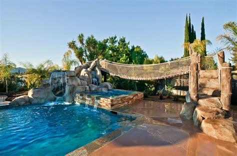 Awesome Backyard Pools 20 Awesome Swimming Pools With Water Slides Homes Of The Rich