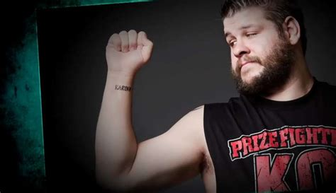 kevin owens wife tattoos theme song net worth and