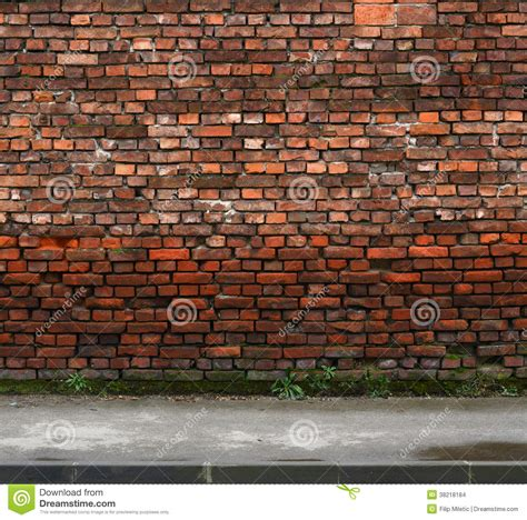 wall photo brick wall with sidewalk stock images image 38218184