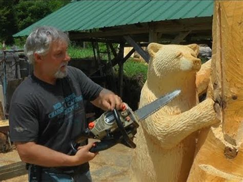 chainsaw artist finds niche carving wood bears youtube
