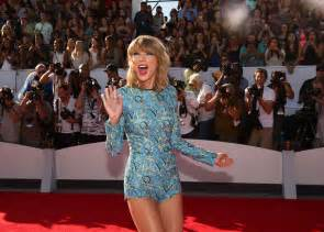 Taylor swift shake it off tops hot 100 again as ariana grande
