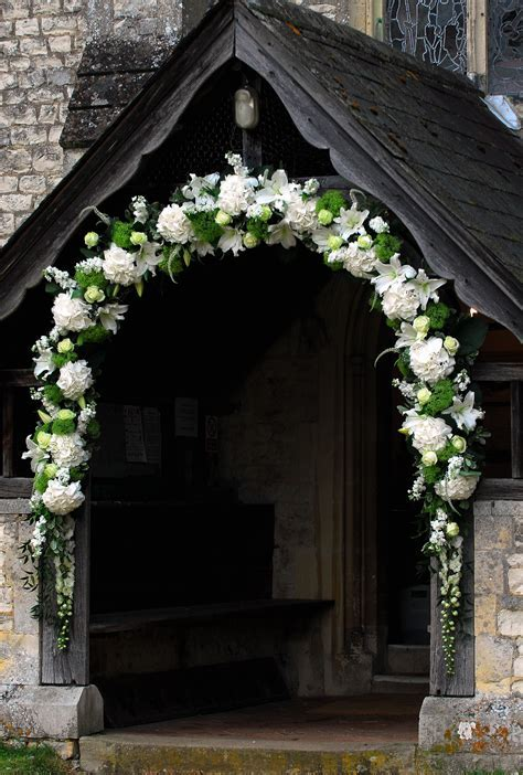 Lovely arch at a church entrance   Wedding Archways