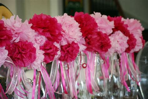 table centerpieces madeof tissue paper pompoms made into a