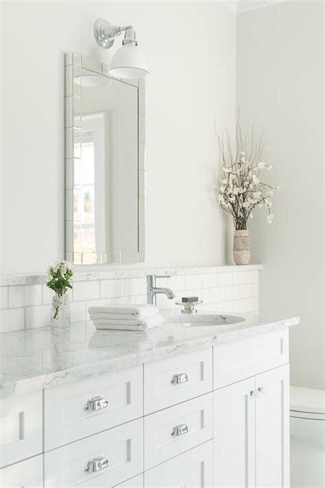 bathroom vanity backsplash ideas white bathroom with marble backsplash ledge transitional bathroom