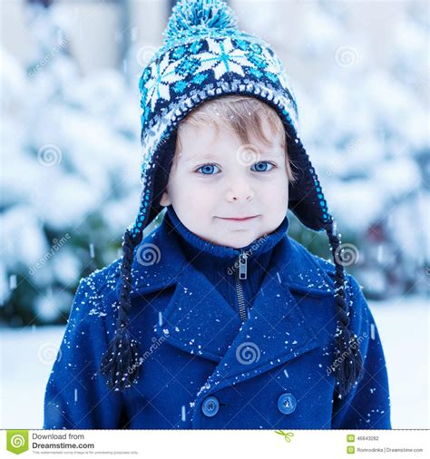 toddler boy winter clothes portrait of toddler boy in winter clothes with