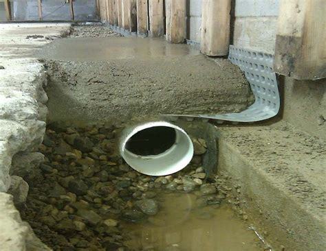 french drain system residential waterproofing commercial waterproofing  wet basement