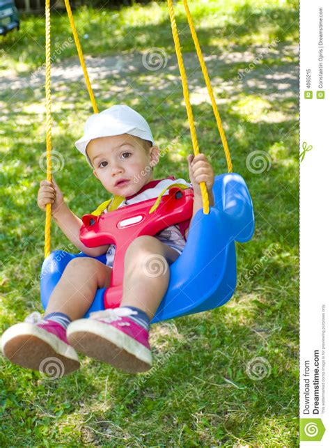 boy swings boy on swing royalty free stock photography
