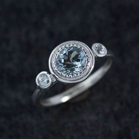 aquamarine sterling silver ring with white sapphire three