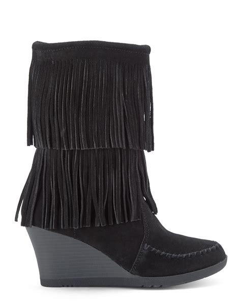 minnetonka black fringe wedge boots in black lyst