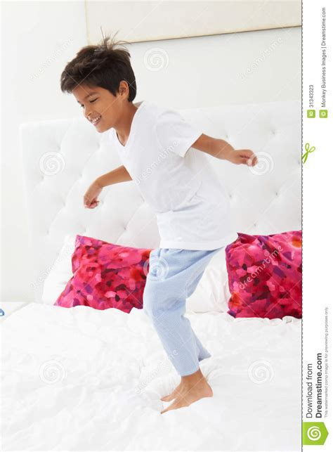 Bed Pjs by Boy Jumping On Bed Wearing Pajamas Stock Photos Image