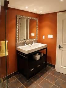 half bath idea warm terracotta walls tile floor