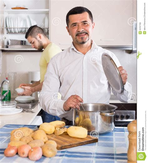two cooking at home stock photo image 53767765
