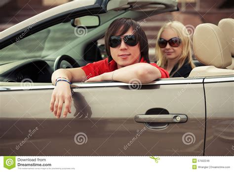 convertible cars for girls happy young couple driving convertible car stock photo
