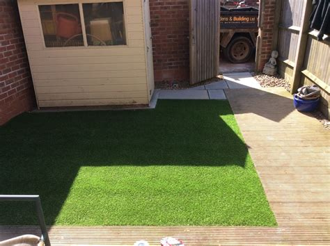 artificial grass with a sandstone feature step golden