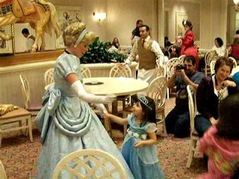 bella and lily dancing with cinderella at the character