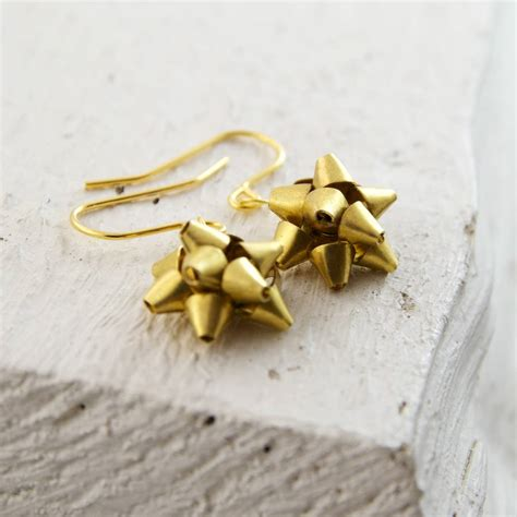 gold gift bow earrings by masquerade