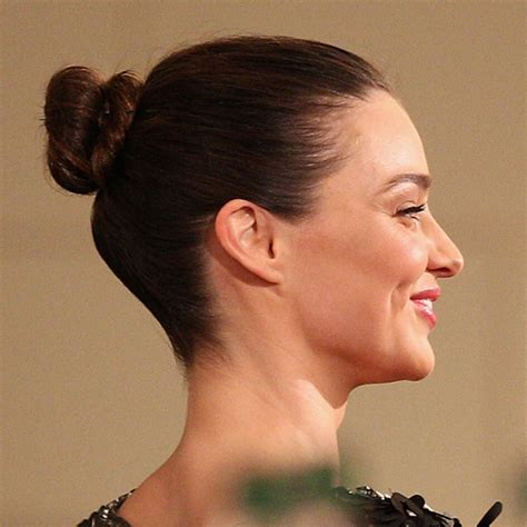 pulled back hair stylenoted newhairstylesformen2014 com miranda kerr s hair was pulled back into a chic bun all
