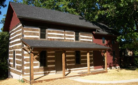 Two Story Tiny House by Welcome To Antique American Log Cabins