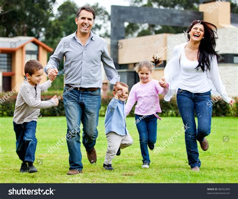 beautiful family beautiful family having fun running outdoors and smiling