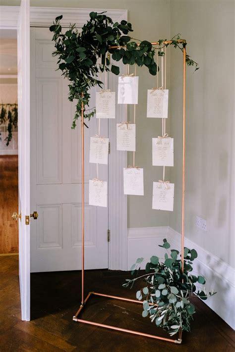 vintage white wedding reception seating chart idea deer pearl flowers