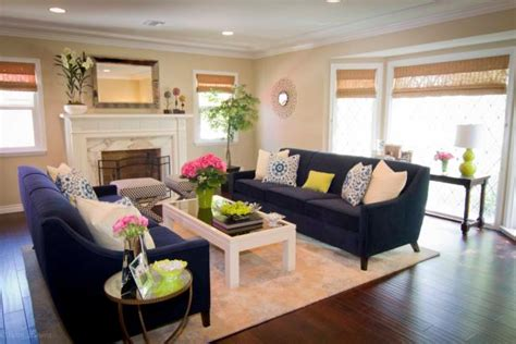 neutral transitional family room with curved sofa and photo page hgtv