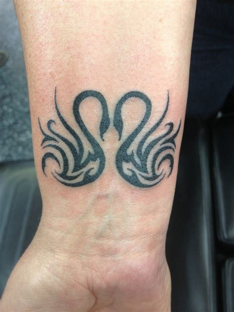 tribal swan tattoo cool tribal black ink swans on wrist