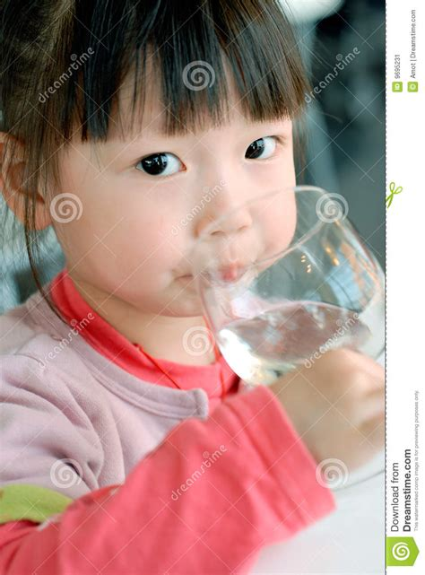 cute asian child drink water stock image image