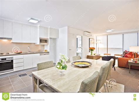 sofa in kitchen diner luxury kitchen with white dining table and sofa stock