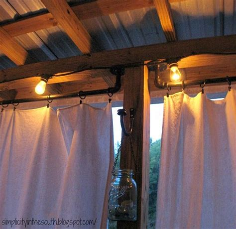 curtain rods made from galvanized plumbing parts a