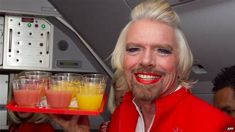 air asia bet virgin s sir richard branson turns stewardess after losing