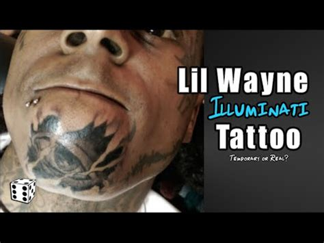 lil wayne gets illuminati tattoo on his face all seeing