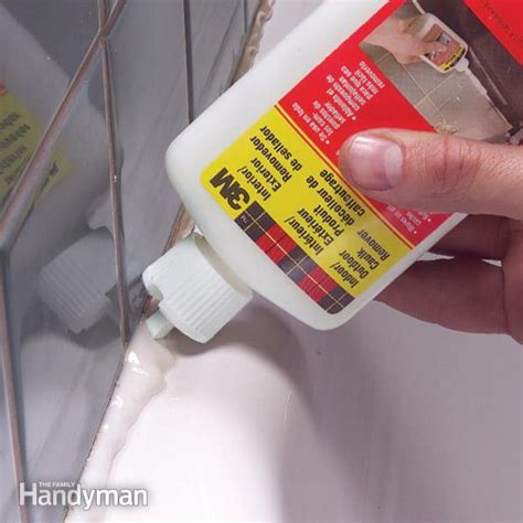 how do i caulk a bathtub how to remove caulk from tub the family handyman