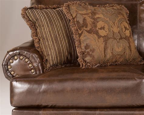 pillows on brown leather couch ashley antique brown bonded leather sofa rolled arms