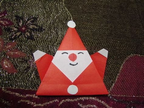How To Make A Origami Santa - origami origami santa claus paper craft on white