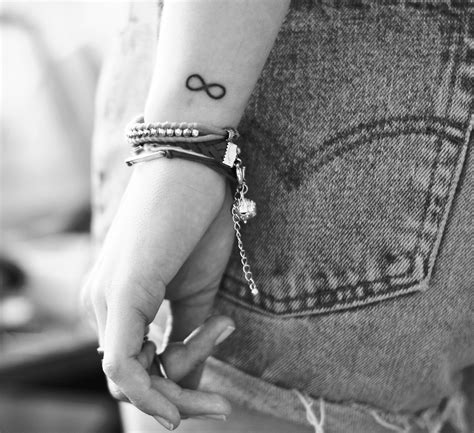 infinity symbol tattoo on wrist infinity tattoos designs ideas and meaning tattoos for you