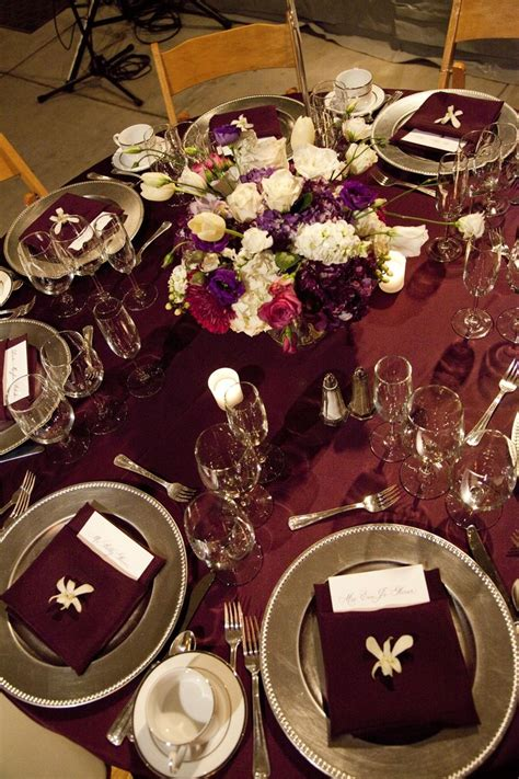 rich burgundy and silver wedding tablescape with gold instead of silver and no orchid on