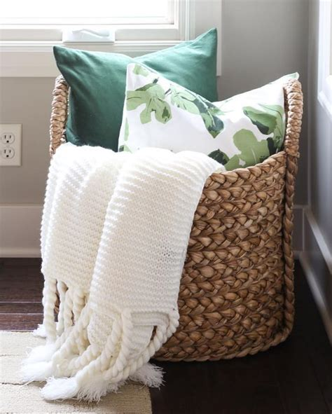 large basket for storing throw pillows 23 ways to declutter your bedroom and make it welcoming digsdigs