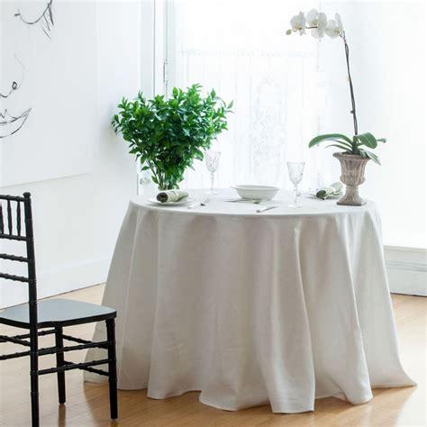how far should a table runner hang huddleson linens