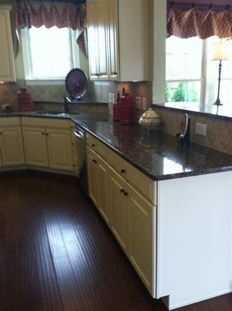 Kitchen Backsplash With Dark Cabinets Baltic Brown Granite Butterscotch Glaze Cabinets Dark